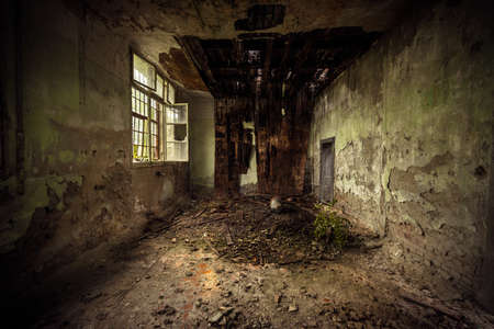 roofed house: Dark damaged room interior with bad rooftop Stock Photo