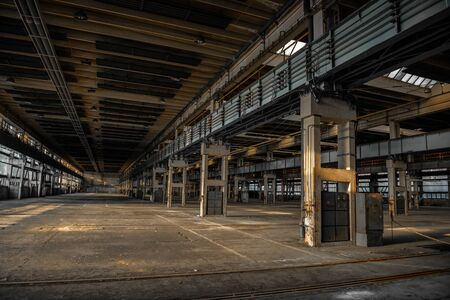 abandoned factory: Large industrial hall of a vehicle repair station