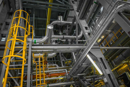 ladder safety: Large yellow ladder in industrial interior Photo