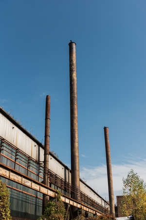 evaporate: Chimney of a Power plant against blue sky