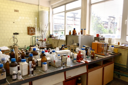 Old laboratory with a lot of bottles recorded with glider