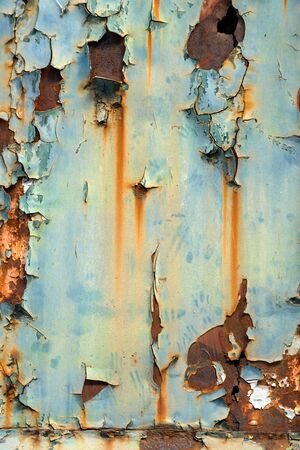metal corrosion: Aged Industrial rusty worn metal closeup photo
