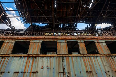 roofless: Messy vehicle interior of a train carriage angle shot Stock Photo