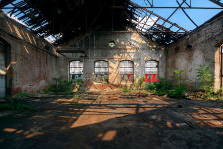 roofless: Abandoned industrial interior with bright light angle