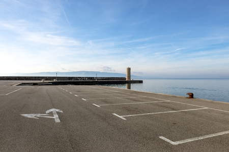 Empty parking lot at the sea under sky