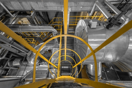 industrial background: Large yellow ladder in industrial interior Photo