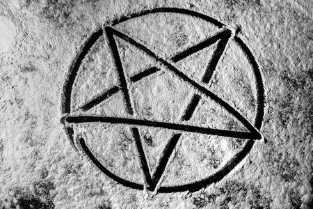 Old steel Pentagram closeup photo on background photo