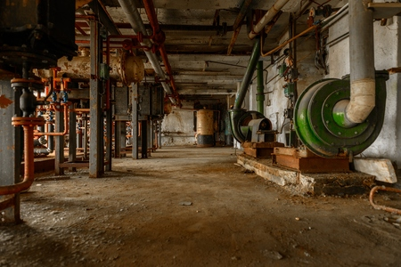 rusty: Dark and abandoned interior of a power plant Stock Photo