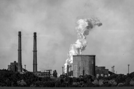 factory power generation: Chimney of a Power plant against blue sky