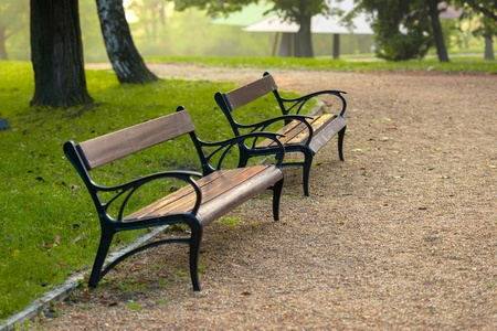 gravelly: Stylish bench in autumn park closeup photo Stock Photo