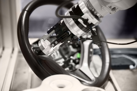 High technology robotic arm closeup photo in factory