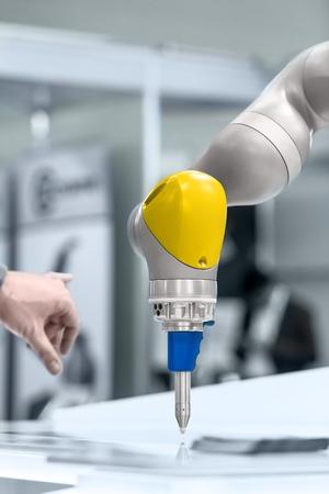 High technology robotic arm closeup photo in factory Zdjęcie Seryjne - 38878735