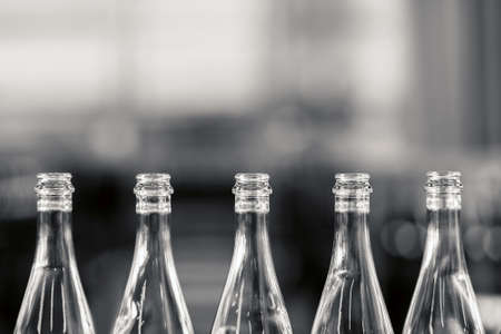 wine and food: Many bottles on conveyor belt in factory Stock Photo