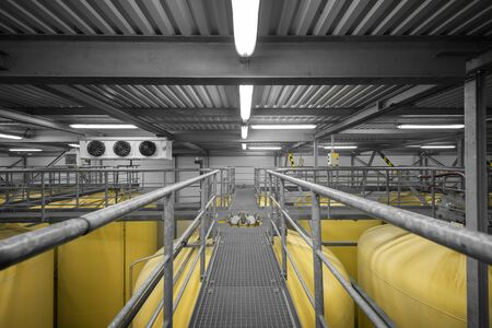 Welded: Industrial interior with welded silos from above Stock Photo