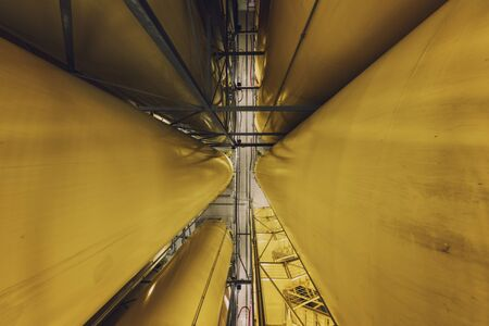 Industrial interior with welded silos from above photo