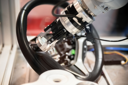 工場のハイテク ロボット アームのクローズ アップ写真 写真素材