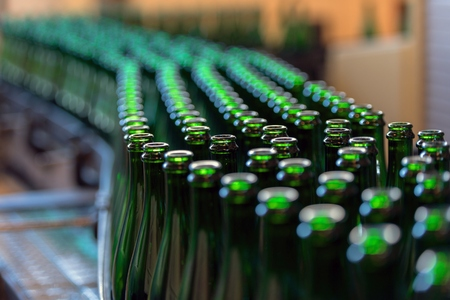 factory line: Many bottles on conveyor belt in factory Stock Photo