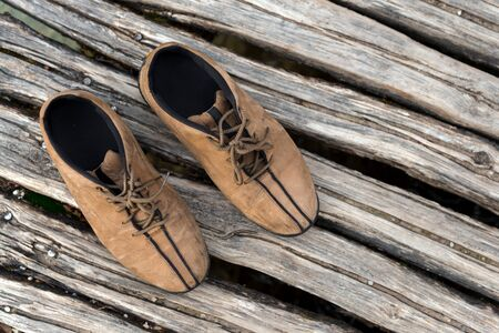 hiking shoes: Pair of hiking shoes on wooden planks Stock Photo