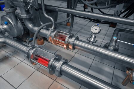 Clean high quality pipeline in industrial interior photo