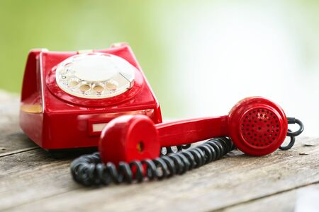 old fashioned: Old Fashioned Red phone on wooden deck