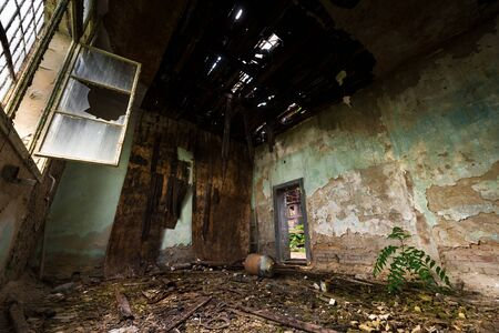roofless: Dark damaged room interior with bad rooftop Stock Photo