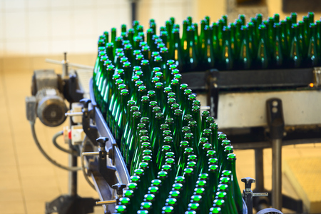 factory automation: Many bottles on conveyor belt in factory Stock Photo