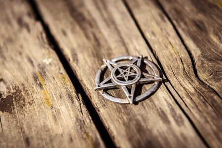 freemasonry: Old steel Pentagram closeup photo on background Stock Photo