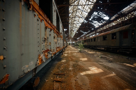 depot: Cargo trains in old train depot eaten by rust