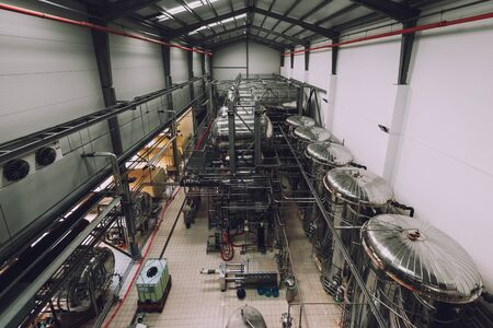 Industrial interior of an alcohol factory with silos photo