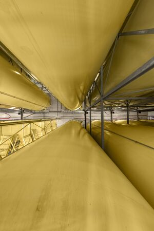 Welded: Industrial interior with welded silos from above Editorial