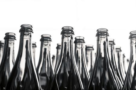 alcoholic drinks: Many bottles on conveyor belt in factory Stock Photo