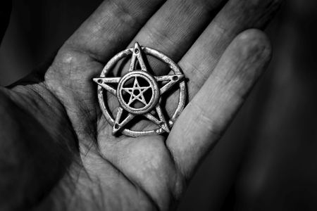 wiccan: Old steel Pentagram closeup photo on background Stock Photo