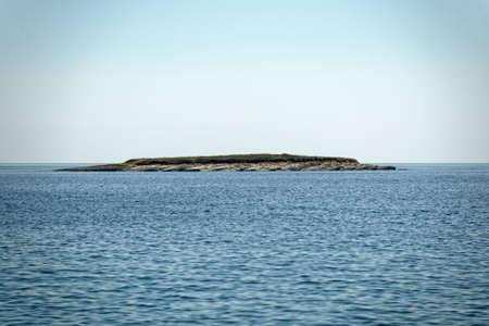 scenic view: Scenic view of a small island in the sea