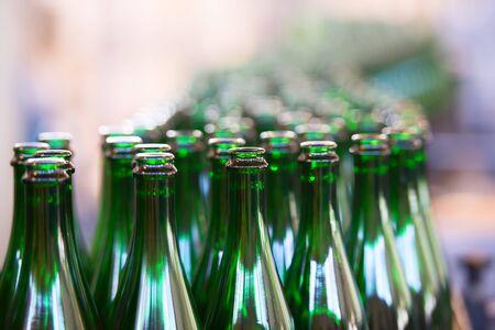 green line: Many bottles on conveyor belt in factory Stock Photo