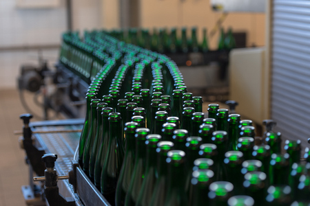 food industry: Many bottles on conveyor belt in factory Stock Photo