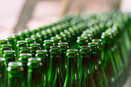 conveyor belt: Many bottles on conveyor belt in factory Stock Photo