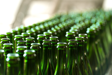 glasses of beer: Many bottles on conveyor belt in factory Stock Photo