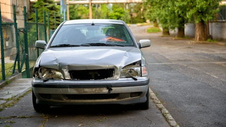 junk car: Damaged car after the accident closup photo