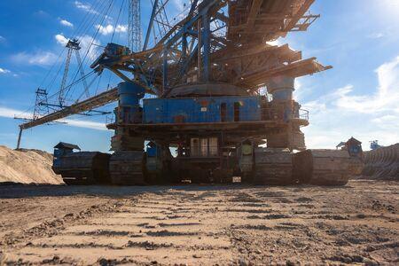 goldmine: Large excavator machine in the mine working Stock Photo