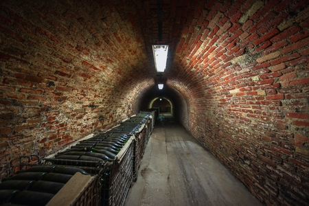 making hole: Long underground brick tunnel angle shot dark Stock Photo