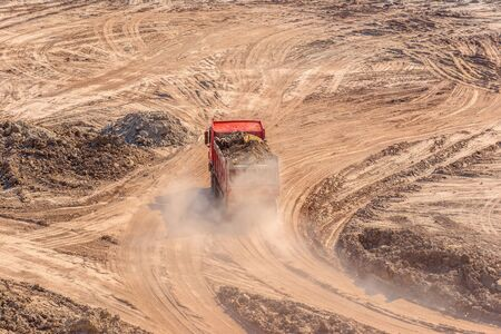 Excavation site with construction machine at work Stock Photo