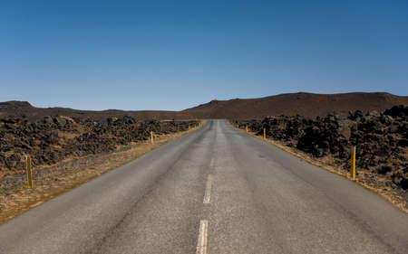 long road: Long road going trough the beautiful nature Stock Photo