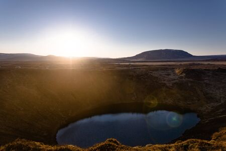 crater lake: Kerid volcanic crater lake in Iceland at sunset