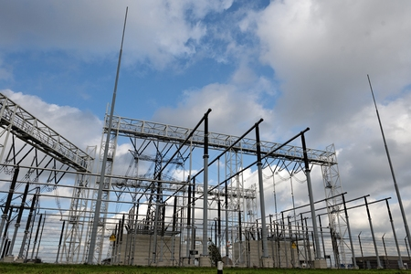 electric station: High voltage electric station under blue sky Stock Photo