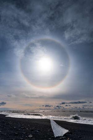 Sun halo on the shore of Jokulsarlon glacier lagoon