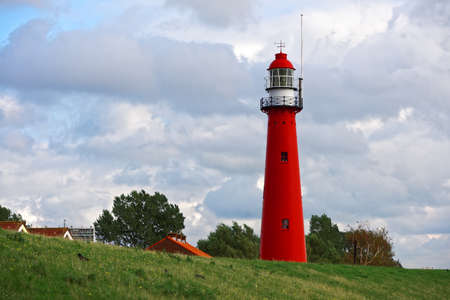 lighthouse keeper: Photo of a Red lighthouse standing on the hill