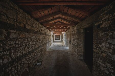 godforsaken: Abandoned and desolate passage made out of stone Stock Photo
