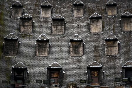 many windows: Many windows on the roof walled up Stock Photo