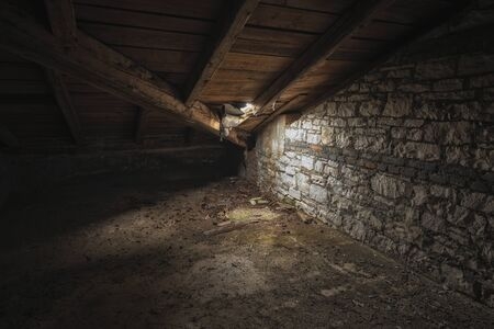 godforsaken: Abandoned and desolate interior of an attic