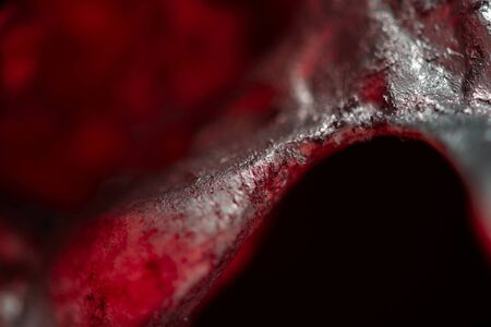 gore: Abstract steel bacgkround closeup photo with red glass